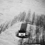Lone White House in Snow, Scottsville, New York, 1982. USA Northeast. copyright photographer Marilyn Bridges.
