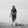 Woman with Offerings on Ganges Riverbank, Chaat Festival, 1993. India. copyright photographer Marilyn Bridges